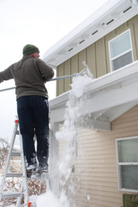 Roofing company can remove snow safely from roof